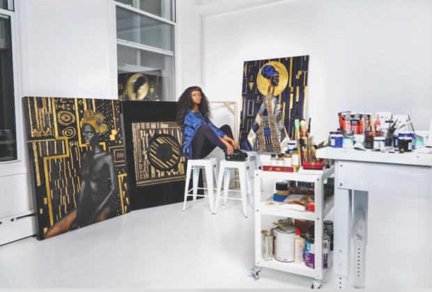 Lina Iris Viktor poses with her artwork